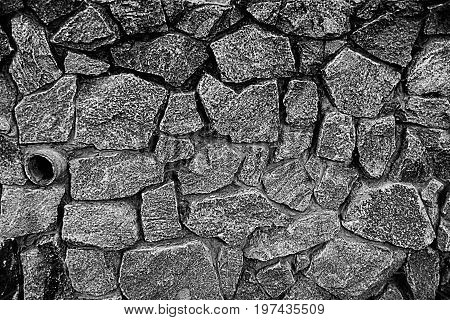 Gray stone texture from a fragment of the basement with large cobblestones