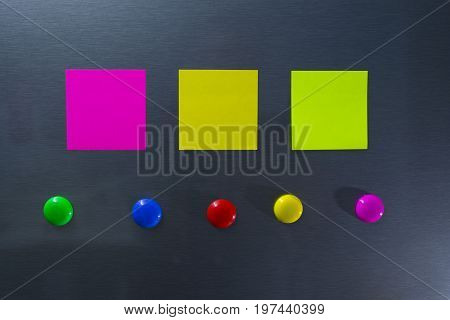Empty Paper Sheet On Refrigerator Door. Note Paper With Magnetic Circle.