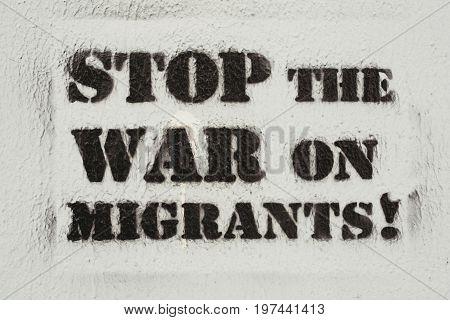 NOVI SAD SERBIA - JULY 24 2017: Stop the war on migrants stencil graffiti on the wall