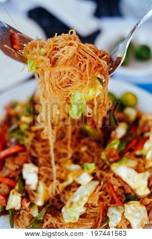 Tasty stir fry rice noodle with meat and vegetables Asian food celebration