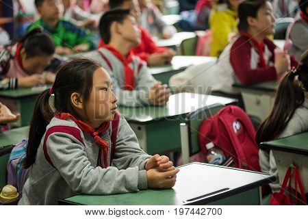 Chengdu, Sichuan Province, China - March 31, 2017: Pupils attend a lesson in a classroom