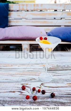 Vermouth cocktail with orange and cherry fruit in the glass