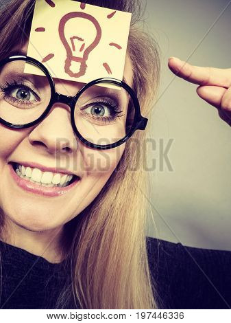 Woman Having Light Bulb Mark On Forehead Thinking