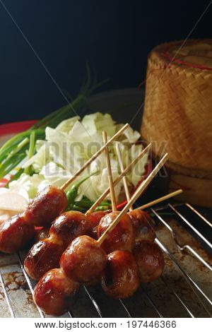 Thai sausage ,pork mix rice sausage from northeastern in Thailand  very famous traditional Thai food/ Thai street food