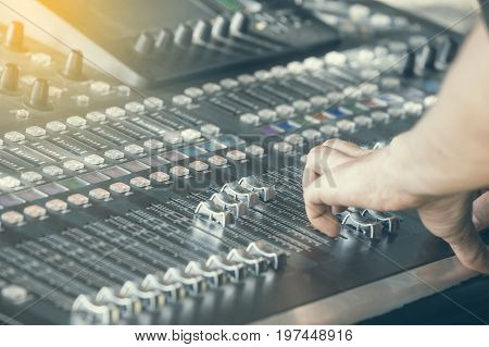 Fingers Move The Sliders On The Big Sound Mixer