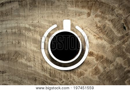 Coffee cup with power-on symbol over the wooden background. Energy and active concept