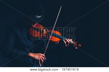 Violin player in dark studio Musical concept