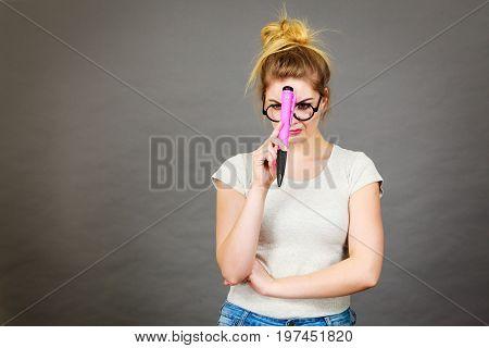 Woman Holding Big Oversized Pencil Thinking About Something