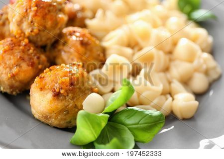 Plate with turkey meatballs and pasta, closeup