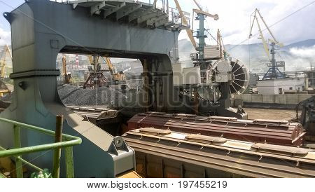 Port Cranes And Vessels, Warehouses And Docks. Industrial Landscape Of Developed Seaport Infrastruct