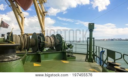 Mechanisms Of Tension Control Ropes. Winches. Equipment On The Deck Of A Cargo Ship Or Port
