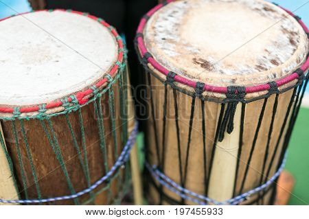 drum, percussion musical instruments and culture concept - closeup on traditional african djembe, summer outdoors concert performance, ethnic rhythm joy show, selective focus