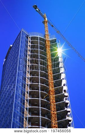 construction of modern skyscraper and building crane