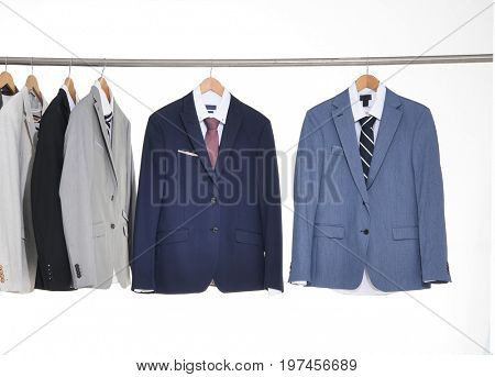 man suit ,Shirts with ties on wooden hangersman suit ,Shirts with ties on wooden hangers