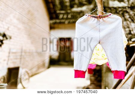 view on laundry of children on clothesline in China