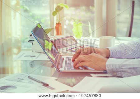 Business Man Typing On Laptop Keyboard During Working At Home Office