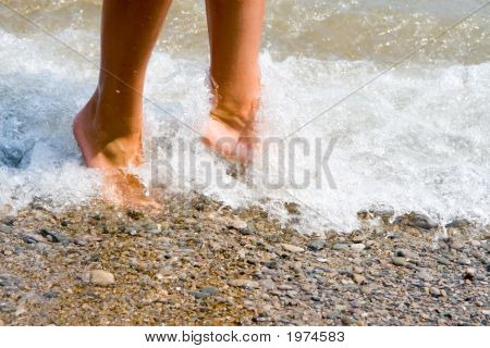Woman Feet In The Beach