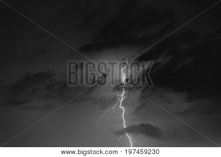 Lightning Bolts Against The Backdrop Of A Thundercloud.