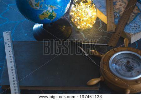 Still life globe on a black matte background with a barometer
