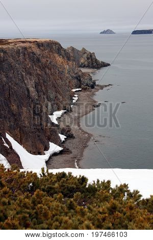Shore of the sea of Okhotsk. Spring Peninsula Taigonos Magadan region Siberia far East Russia