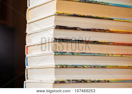 A stack of books in multicolored covers in the library or bookstore.