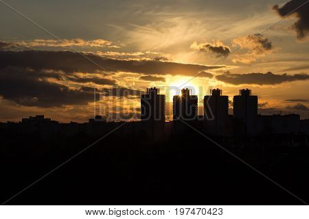 black building houses at sunset with backlighting