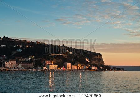 Colorful architecture at sunset, panoramic view of Piran bay, small coastal town in Istria, Slovenia