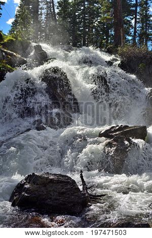 Waterfall Swelled To A High Level From Snow Melt with Mist