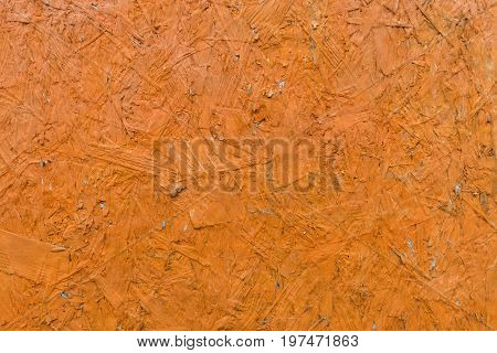 Structure of glued wood chips dyed orange