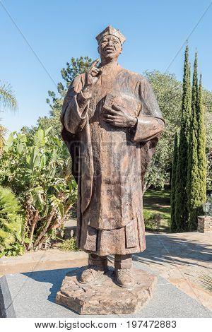 WINDHOEK NAMIBIA - JUNE 17 2017: Statue of Reverend Theofelos Hamutumbangela at the Tintenpalast (German for