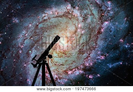 Space Background With Silhouette Of Telescope. Messier 83, Southern Pinwheel Galaxy, M83 In The Cons