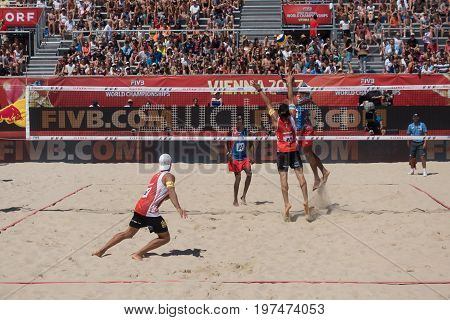 Vienna - July 29 2017: players Nivaldo Diaz and Sergio Gonzalez from team Cuba win in two sets against players Dressler and Kunert from team Austria at the Beach Volleyball Worldchampionships 2017 on the Vienna Donauinsel