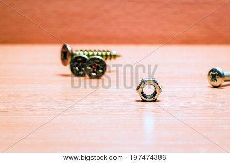 Shiny metal tools for fasteners is a nut and screws they are hard and durable so it is good to fasten objects together