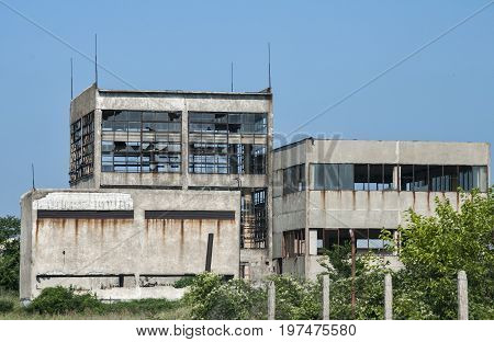 Abandoned and crumbling vintage obsolete industrial building