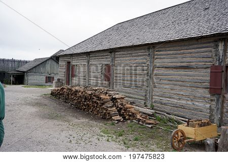 A pile of firewood lies behind a longhouse in Fort Michilimackinac, in the Colonial Michilimackinac State Park, in Mackinaw City, Michigan.
