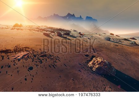Sun over Mars, landscape in the mist, mountains and meteorites