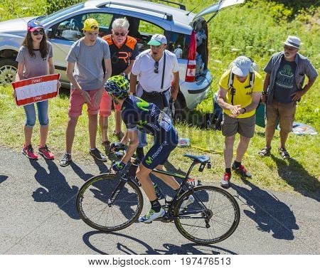Col du Grand ColombierFrance - July 17 2016: The Spanish cyclist Ion Izagirre of Movistar Team riding on the road to Col du Grand Colombier in Jura Mountains during the stage 15 of Tour de France 2016.