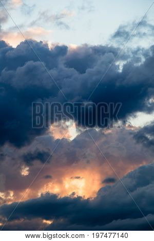 magical sky with smoky stratocumulus clouds at sunset