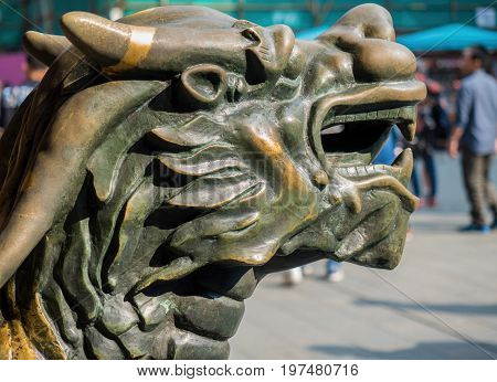 Shanghai, China - Nov 6, 2016: Closeup bronze head of Chinese Qilin (Kirin in Japan) standing guard at a public thoroughfare. This is a mythical creature of Chinese legends.