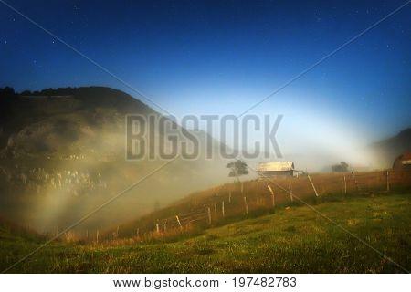 white rainbow (halo) in the mountains