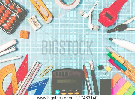 Frame Of School Education Supplies On Blue Plastic Cutting Board Mats With Copyspace For Education B
