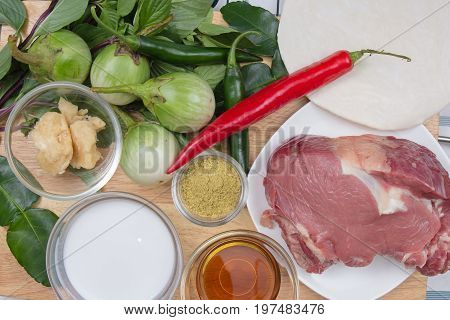 Ingredients for cooking Green curry / green curry powder red and green chili eggplant sweet basil kaffir lime cooconit palm sugar fish sauce and beef / cooking green curry concept