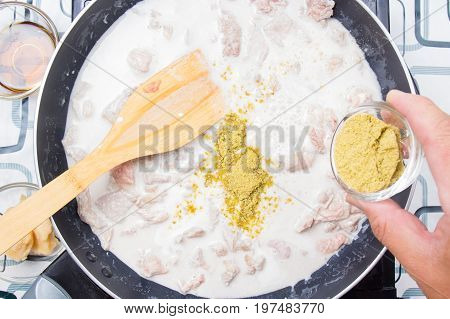Chef putting green curry powder for cooking / cooking green curry concept