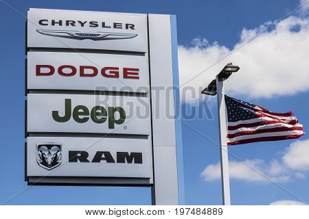 Indianapolis - Circa July 2017: Logo and Dealership Signage of the four American Subsidiaries of FCA - Chrysler Dodge Jeep and Ram Trucks VII