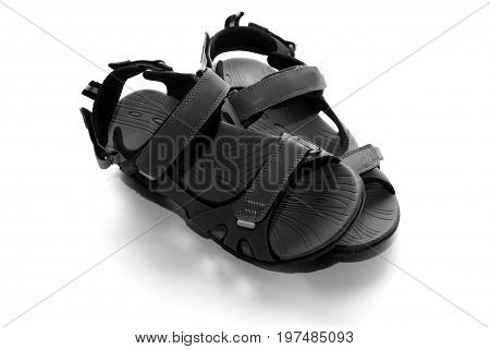 Sandals background / Sandals are an open type of footwear, consisting of a sole held to the wearer's foot by straps going over the instep and, sometimes, around the ankle