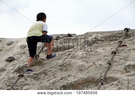 Japanese Boy Climbing On The Wall (second Grade At Elementary School)