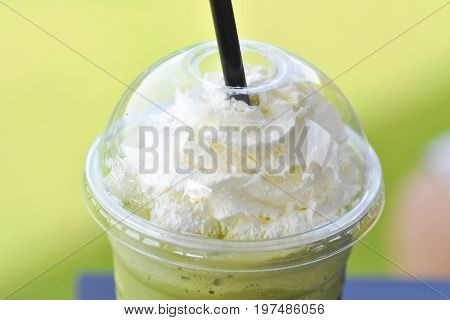 green tea frappe with whipped cream topping or milk green tea