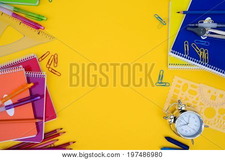 back to school styed scene with school supplies on yellow