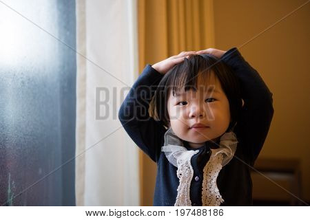 Little Child Standing By Window