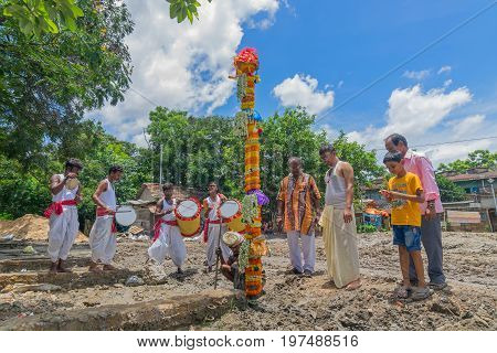 HOWRAH WEST BANGALINDIA - JULY 7TH 2017 : khutipuja the starting ritual of world famous Durga Puja (most famous festival of Hinduism) is being performed by a Hindu devotees with dhakis performing behind.